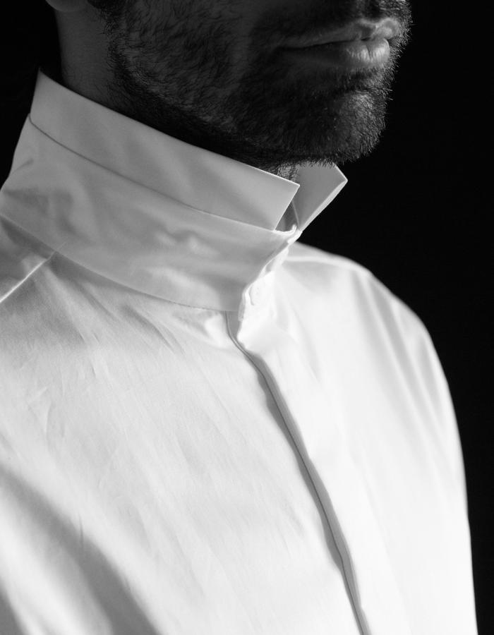 Plein white shirt with a standing collar and broad cuffs.