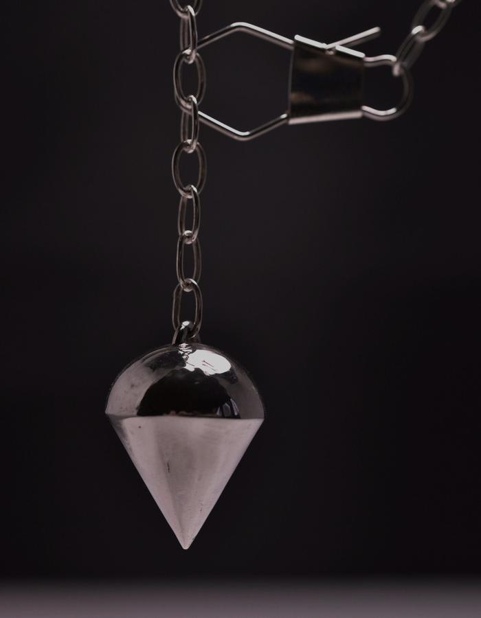 Billie M Vigne Plumbbob pendant on chain with safety pin clip.