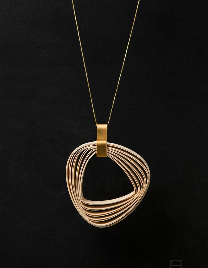 Spiral necklace with urban chic. Unique and contemporary handmade and assembled with 18k gold plated brass elements.