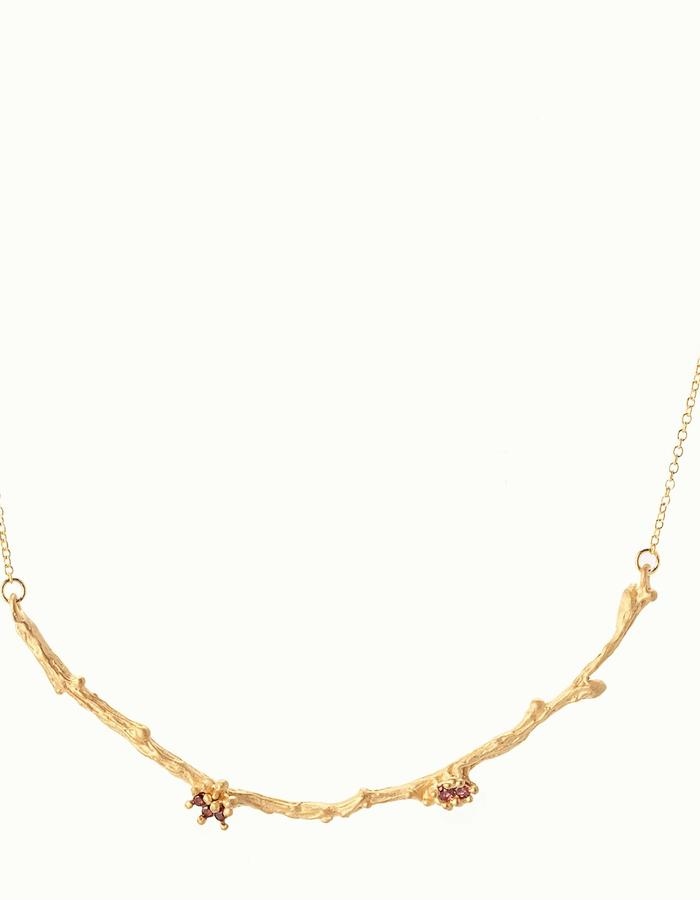 "Arcbranch necklace- gold: Nature inspired delicate refined necklace accentuates your neckline with beautiful red sapphires and garnets, 14k gold pendant and chain matte finish. Wear it with a casual outfit or your new evening dress. 8x0.5x0.5cm, 14"" long."