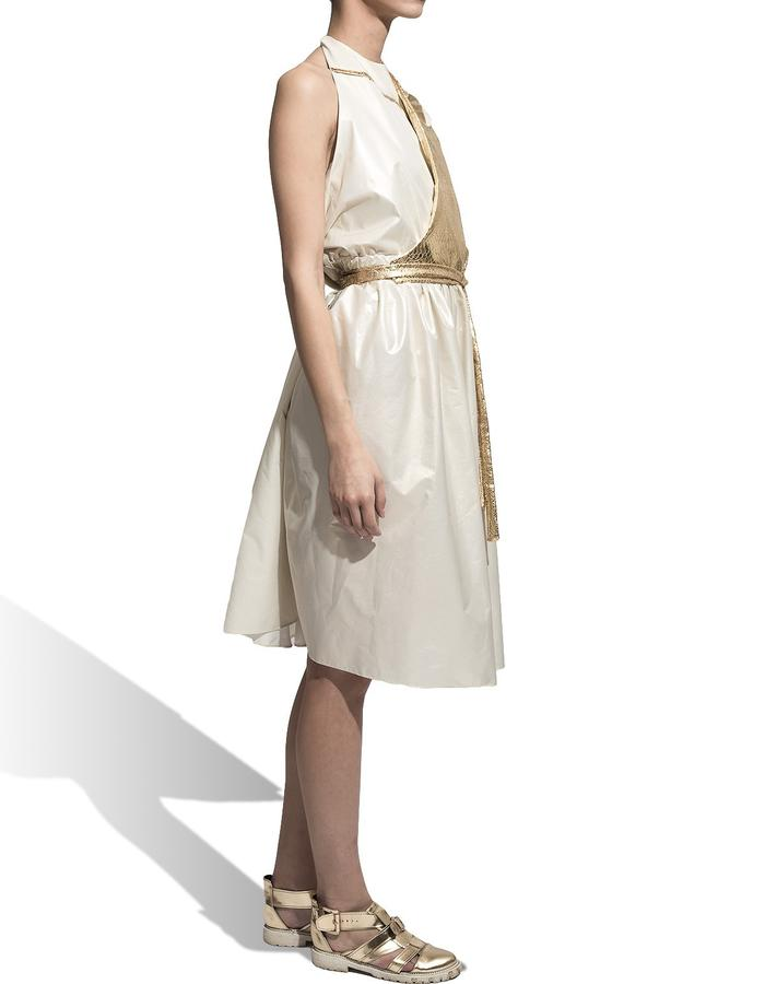7. SIDE Product name : Gold Dress Product description: Backless midi dress with side pockets. The dress has a manoeuvrable gold flap with a long cord. (you can move the flap either up front or back). At the neckline it closes with an cotton string . Fabric: waterproof slicker, faux leather Fabric composition: 100 % synthetic. Cleaning and maintenance suggestions: dry cleaning Size: M / unique product