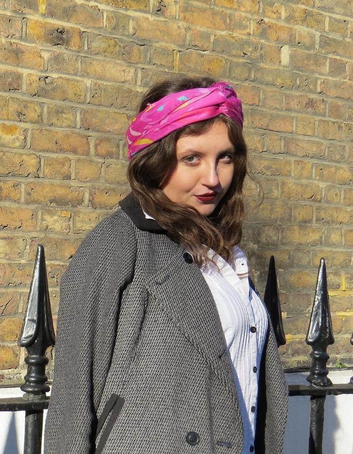 Lindisfarne Rose scarf by Liz Nehdi styled as a headband