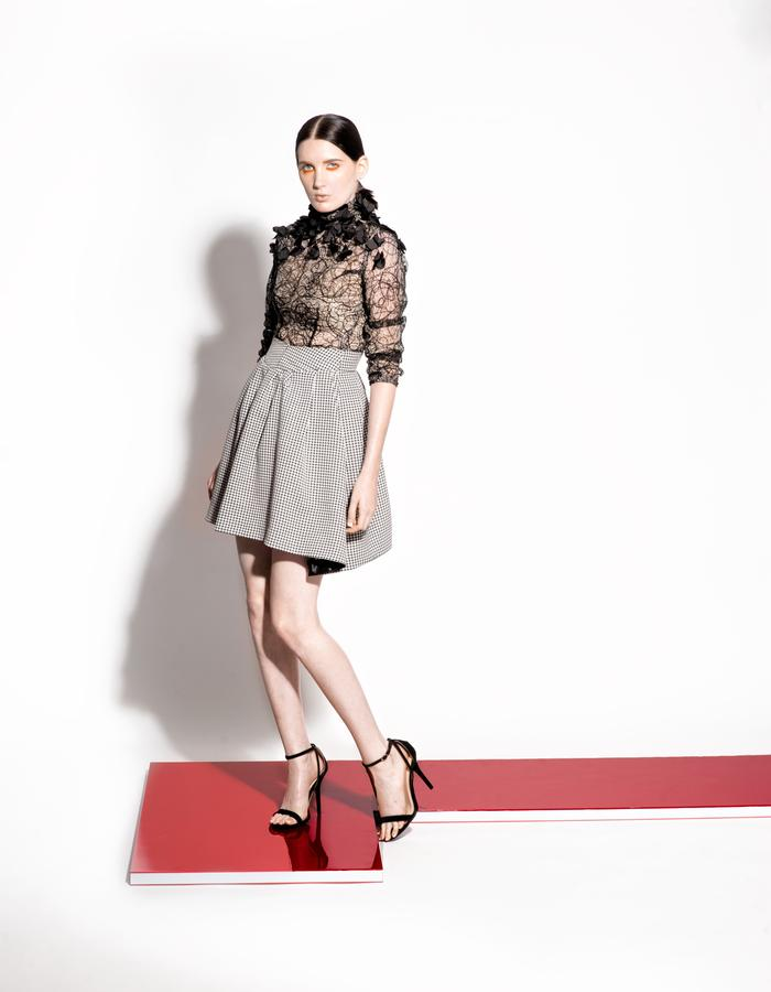Christian Allana Look1- Abstract Lace and Mesh Bodysuit with Floral Appliqués paired with a Tweed Circle Skirt