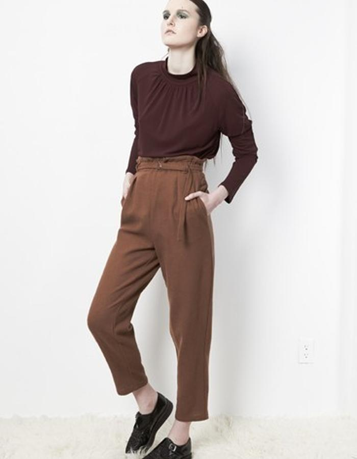 Anderst Morla Finna Raglan Mock Neck Top Style# 0215 maroon rayon matte jersey, silver closure in back, Daria Tapered pants Style#0312 walnut wool, pleated elastic waste