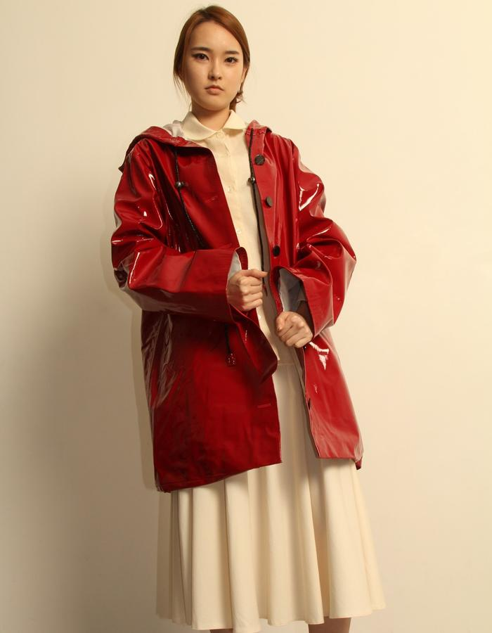 Red patent leather coat. Lined.
