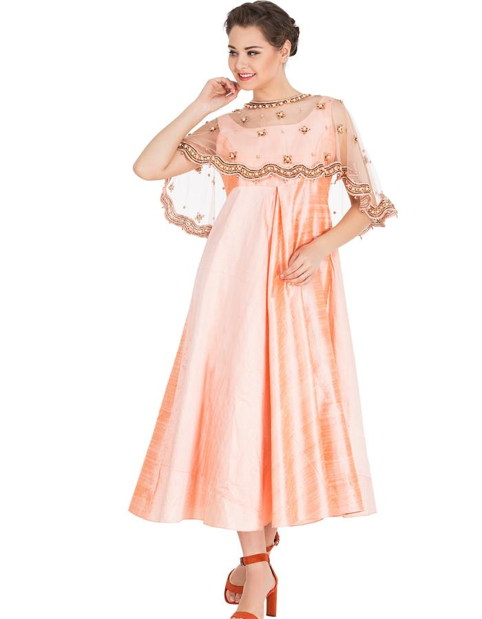 """Featuring Peach  Raw Silk Center Inverted Pleated Dress  embroidered with brass flowers,  crystals and pearl. With Cigrette Pants COMPOSITION: raw silk, Net Lining: Butter crepe CARE: Dryclean only.  Measuments ( in inches) M : Bust -  36"""", Waist - 28"""", Hip - 40"""" L: Bust - 38"""", Wait -30"""", Hip - 42"""" Skirt length: 42"""""""