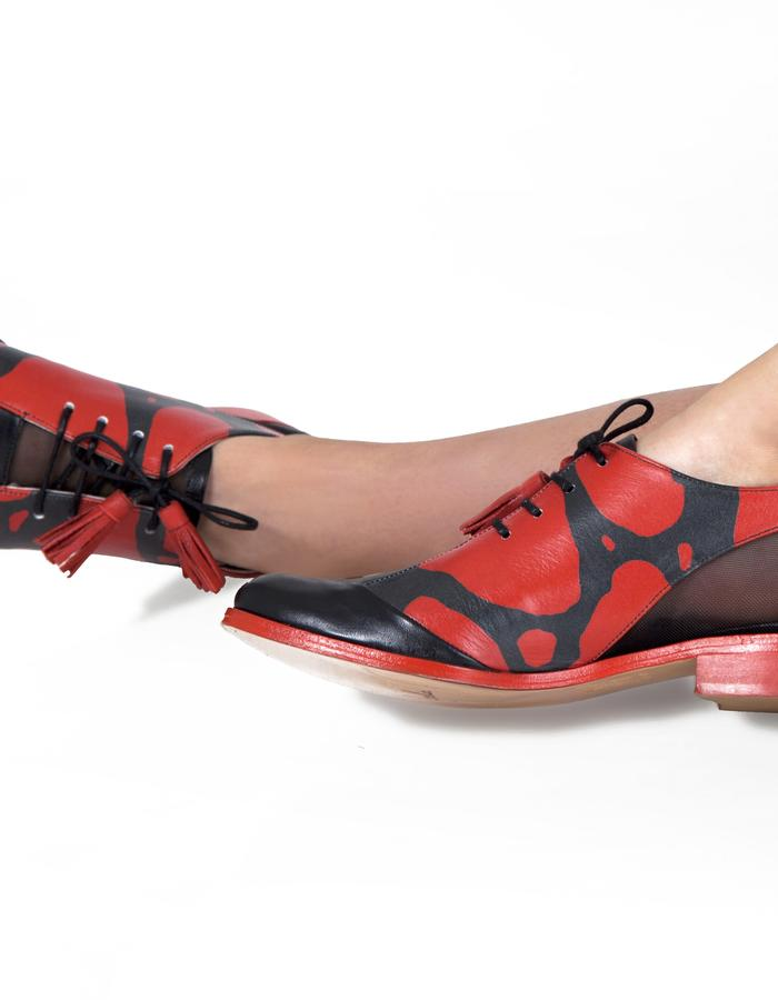 red and black poison dart frog printed leather oxford brogues with red leather sole and tassels.