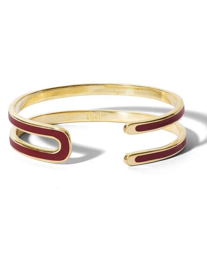 'U' gold plated cuff with bordeaux enamel.