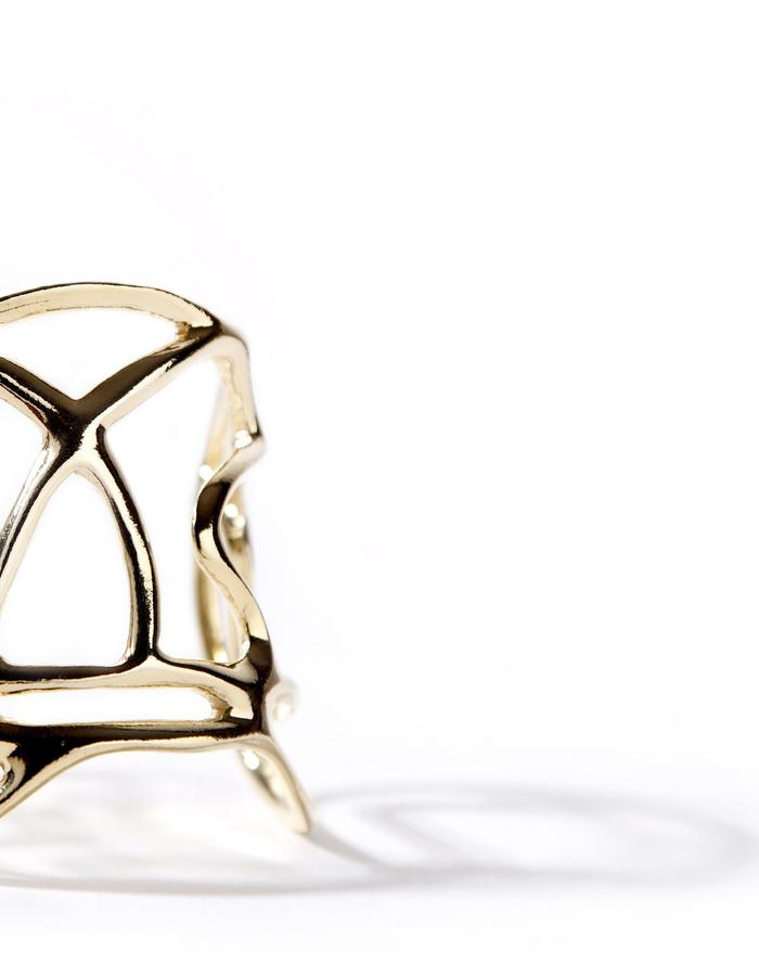 'Line one' gold plated cuff.