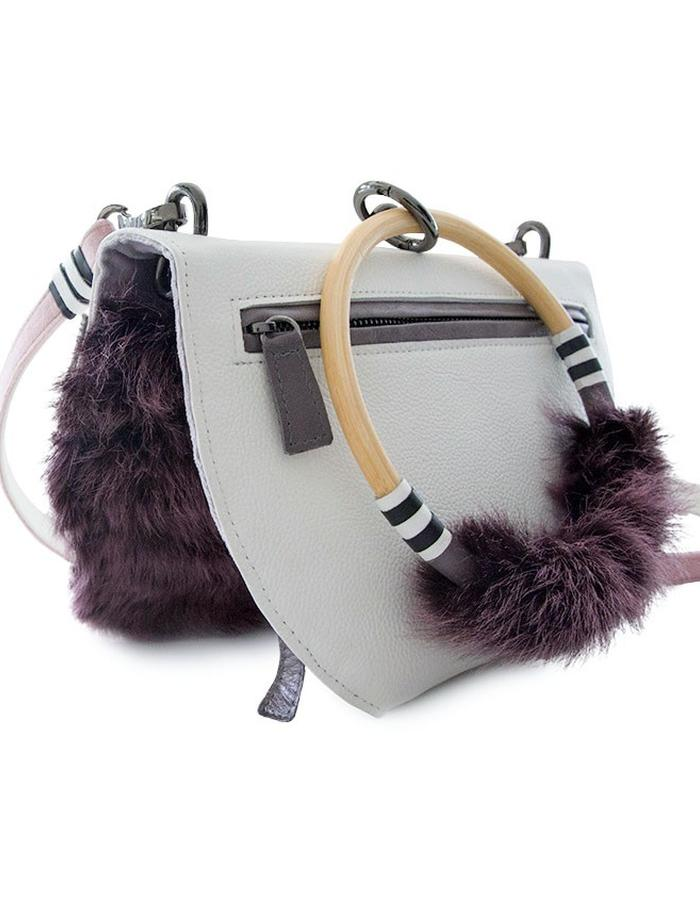 Tribal City Cross body handbag with leather, velvet and fur detailing. wooden hoop handle with leather stripe design details.