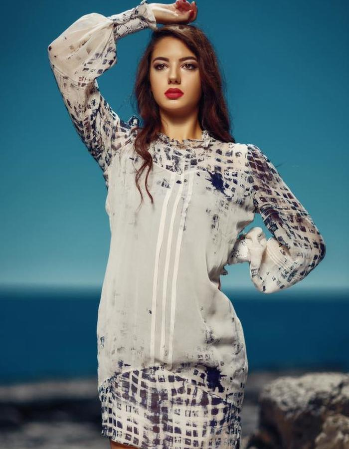 Short silk elegant dress with hand made details on sleeves
