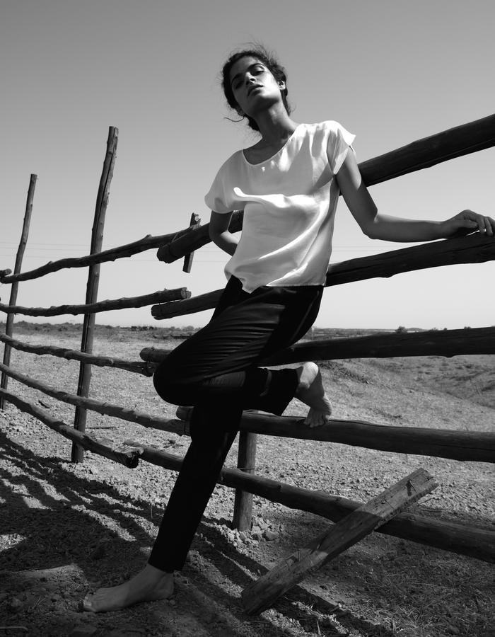 Black pleated pants. Minimal, sustainable work wear.