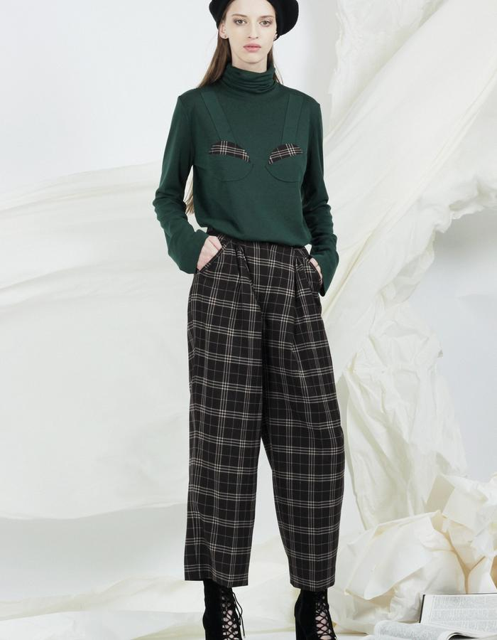 Green turtleneck and wide plaid trousers